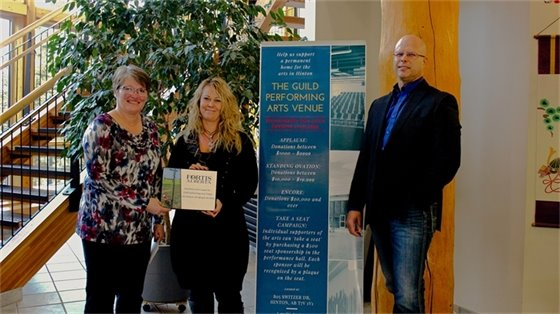 Denise Boutin (ASH) and Councillor Alberta Ostashek accept sponsorship plaque from Nicky Smith (FortisAlberta)