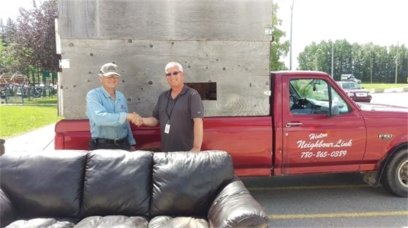 Ron from Neighboulink Presents Ian With New furniture for Youth Centre